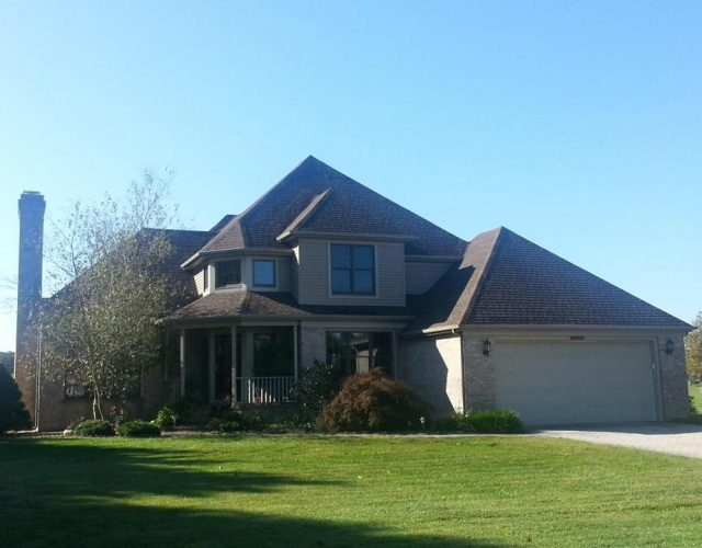 large residential home with new architectural shingle roof