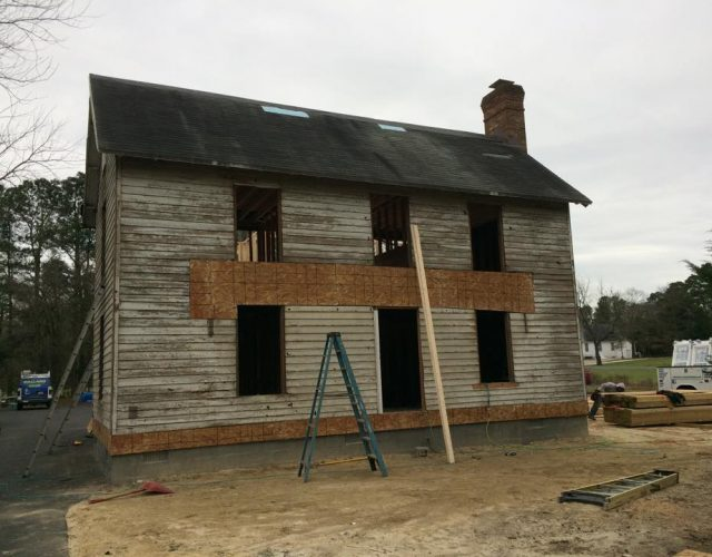 before picture of two story house with old wood siding