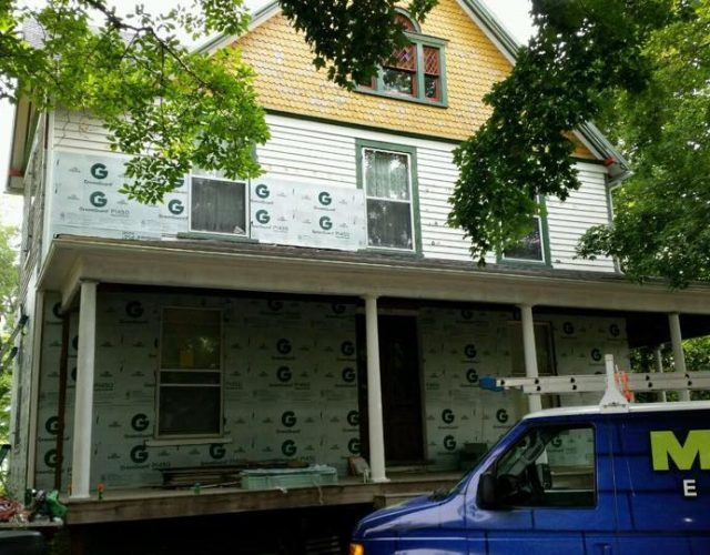 large home in the process of getting James Hardie siding