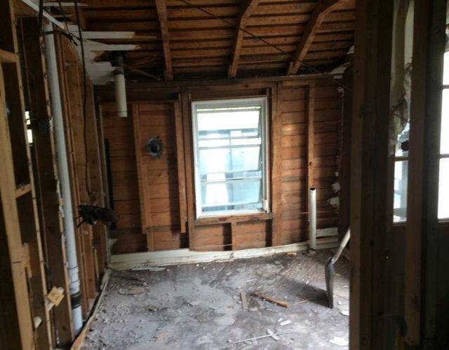 house being prepared for attached garage demolition