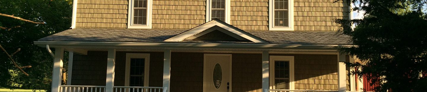 two story home with new roof and cedar shake siding