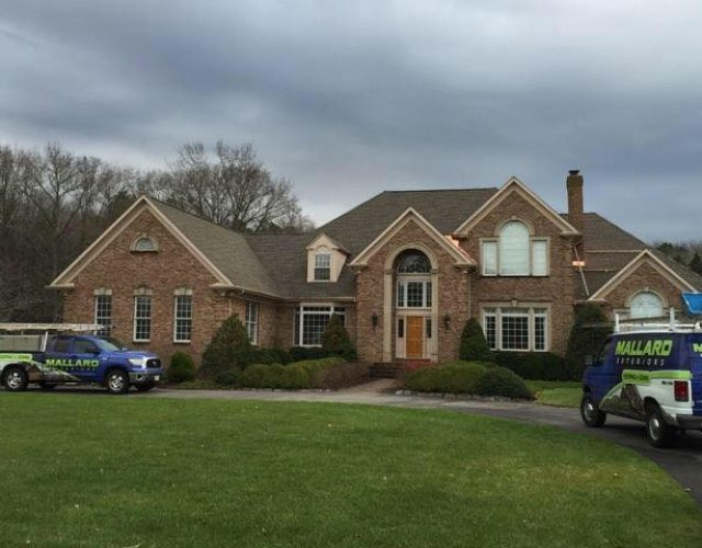 large red brick home with new GAF architectural shingle roof