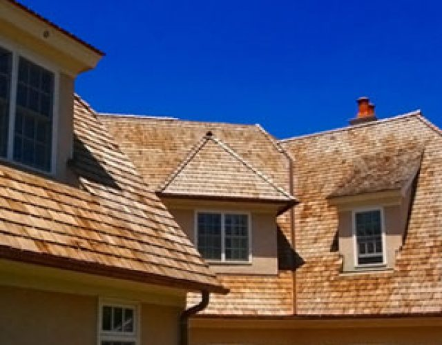 tan cedar shake roofing on house