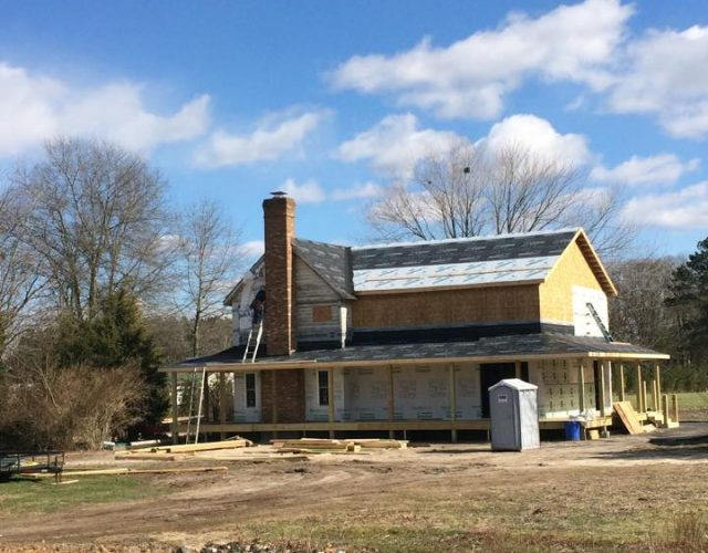 two story home getting new roof and siding