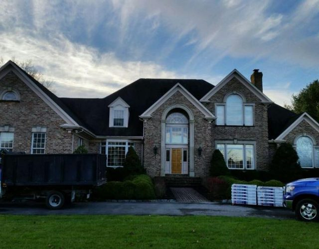 completed GAF architectural shingle roof on large brick Maryland home