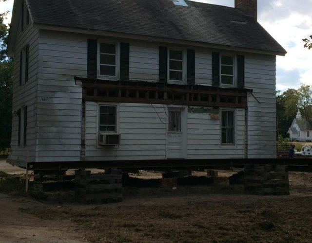 before photo of two story house with old siding