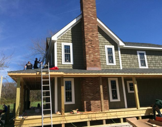 cedar shake vinly siding being installed on home