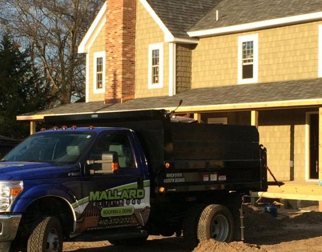 new yellow cedar vinyl siding on home