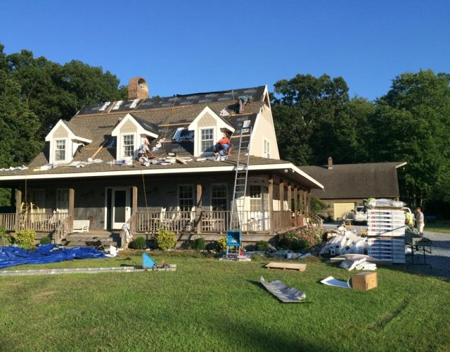 removal of siding and shingle roof from cape cod style home