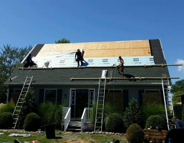 residential house currently getting GAF Timberline shingle roof installed