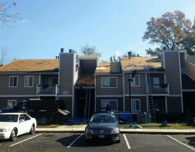 apartment complex during new roof installation