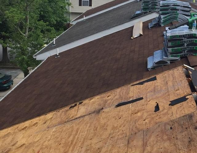 removal of three tab shingles from apartment duplex