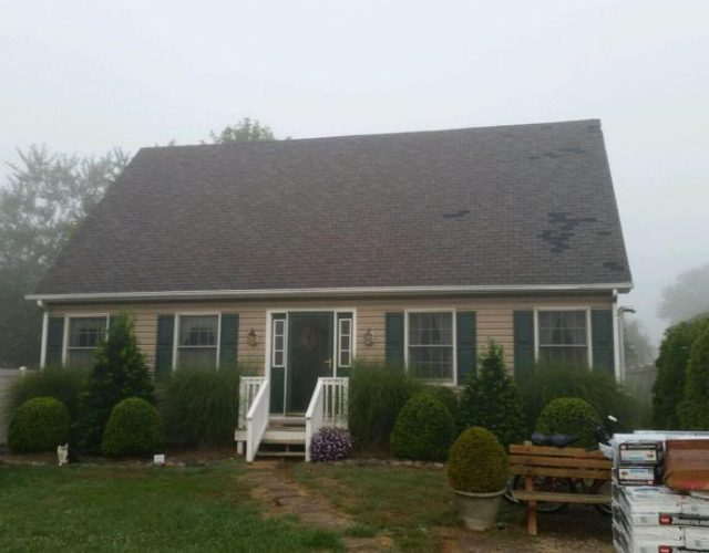 before image of house with cracked shingle roof