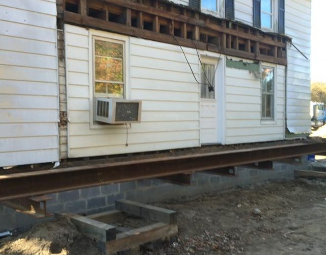 house in the middle of siding removal and siding installation