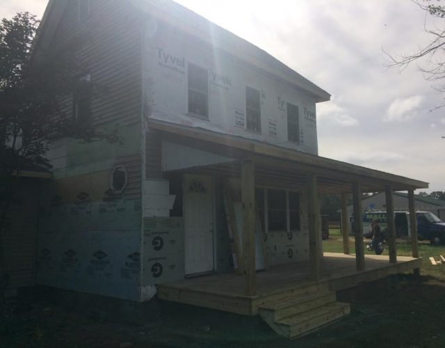 two story house during siding repair