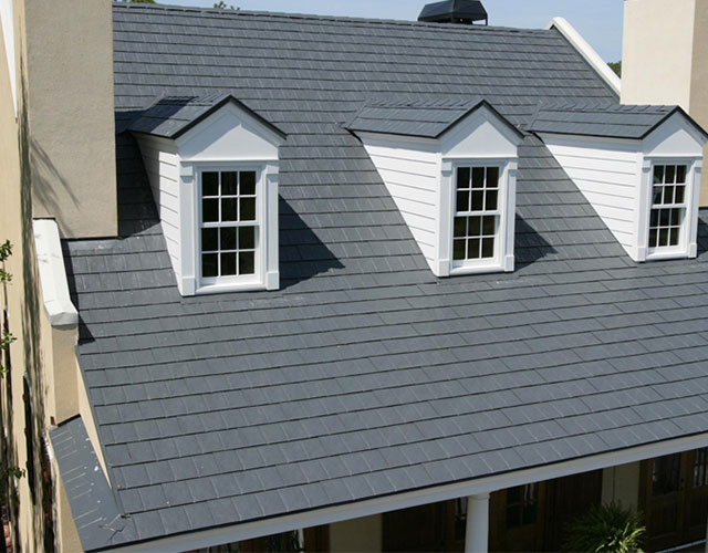 cape cod house with completed slate roofing