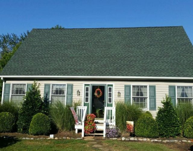 house with new completed green Timberline shingle roof