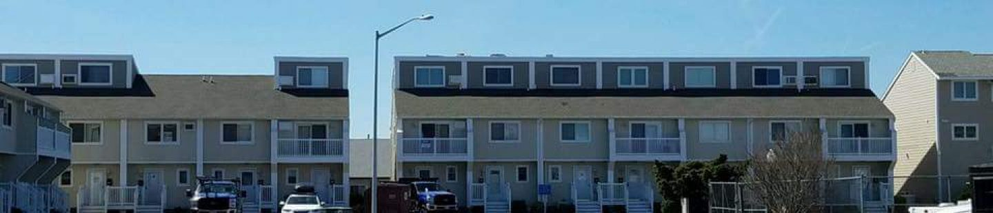 commerical apartment complex getting weathered wood architectural shingles installed