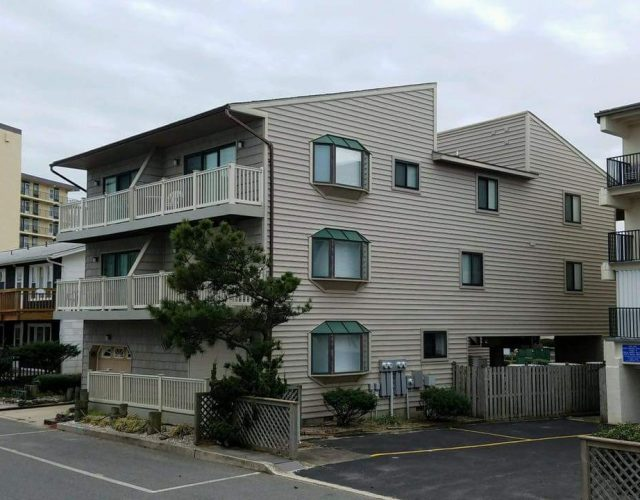 side view of completed condo commercial roof in bethany beach