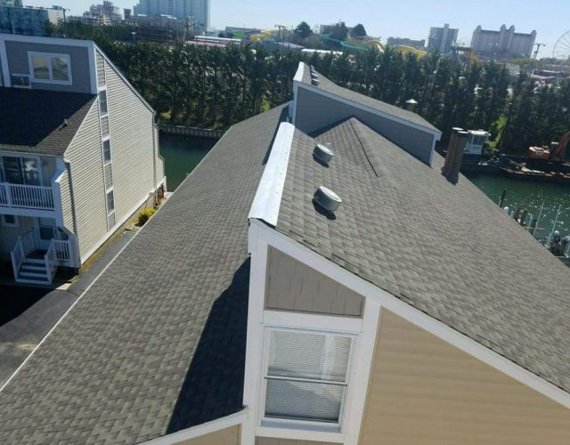 close up of completed condo with architectural shingle roof