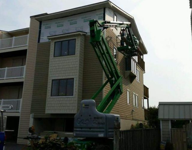 Lift transporting shingles to the roof of a commercial apartment
