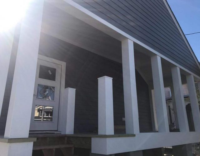 close up view of condo with completed James Hardie siding