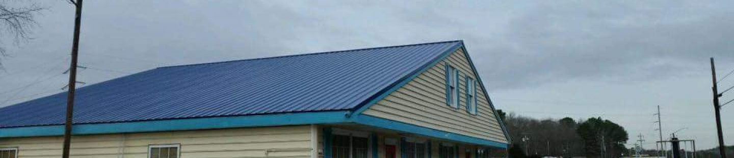 business store front with completed blue master rib metal roof