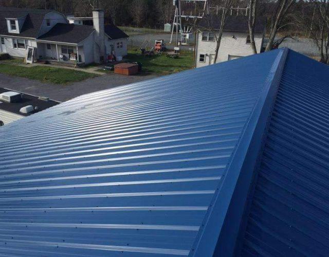 close up of blue rib metal roof