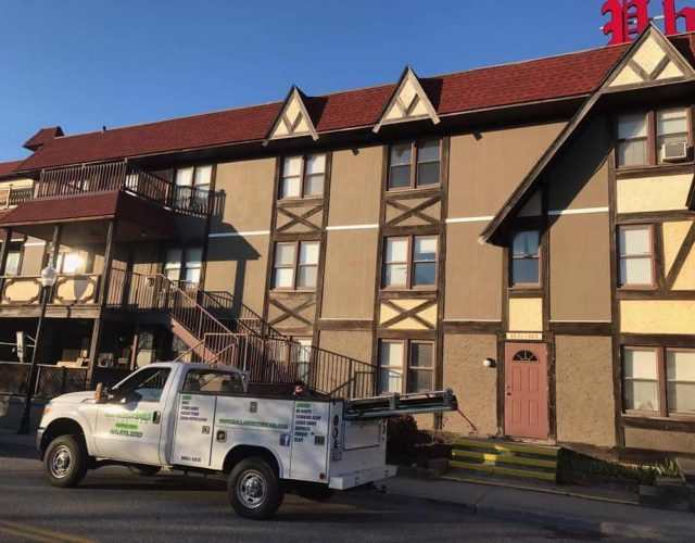 replacing old siding on a commercial apartment building with James Hardie siding