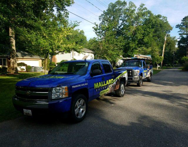 picture of blue mallard exteriors utility truck
