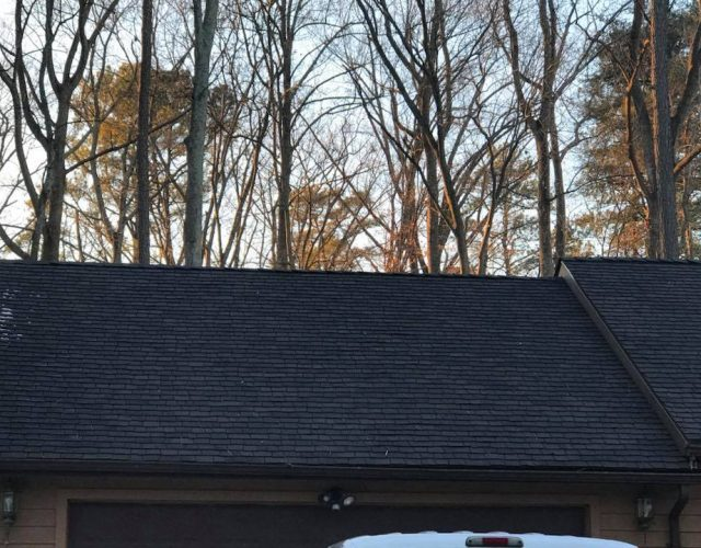completed black cedar shake roofing on home