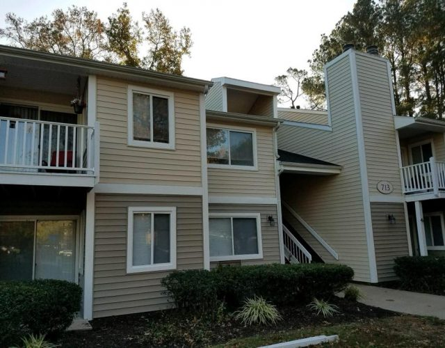 apartment building with completed vinyl siding