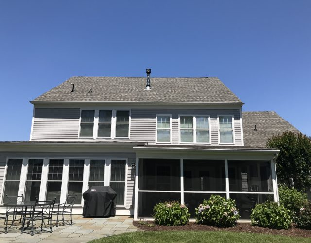 completed asphalt roof on large two story home